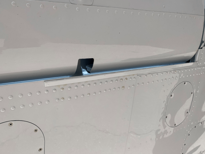 The triangular strip affixed to the Super King Air 200's bottom wing skin just in front of the aileron's inboard end